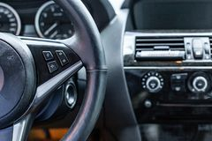 Car interior. Modern car speedometer and dashboard. Luxurious car instrument cluster. Stock Photo