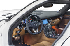 Car interior. Orange cockpit with carbon decoration isolated on white background Royalty Free Stock Photo