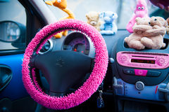 Car interior, with pink details. Stock Photos