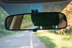 Car interior with rear view mirror and windshield Stock Photos