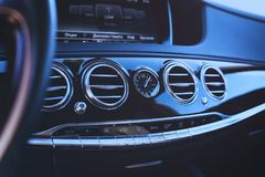 Car interior with shallow depth of field. The grille of the car air conditioner at shallow depth of field Stock Photo