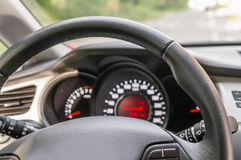 Car interior with steering wheel and dashboard. Vehicle interior with steering wheel and dashboard - car salon concept Royalty Free Stock Images