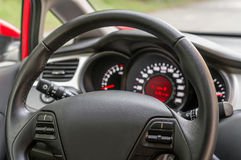 Car interior with steering wheel and dashboard. Vehicle interior with steering wheel and dashboard - car salon concept Royalty Free Stock Photos
