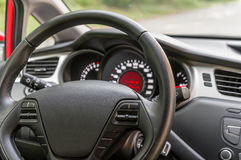 Car interior with steering wheel and dashboard. Vehicle interior with steering wheel and dashboard - car salon concept Stock Photography