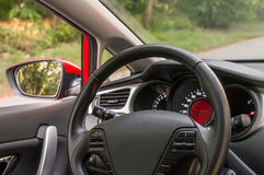 Car interior with steering wheel and dashboard Royalty Free Stock Photo