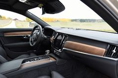 Car interior of a Volvo S90 2017. Inside of a Volvo premium car S90. Brown treepanels with a exclusive and expensive look. Brand new instrumentation of a modern royalty free stock image