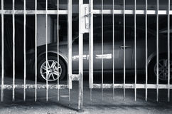 Car and its protection against thieves. Car behind the bars as metaphor of security against thieves royalty free stock photos
