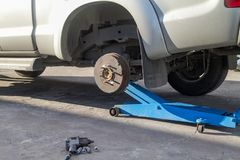 Car jack to lift up pickup truck for remove tire. Blue car jack to lift up pickup truck for remove tire royalty free stock photography