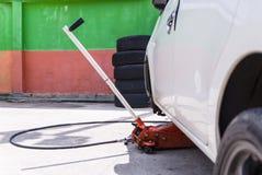 Car jack to lifting the car for replace wheel and repair at gara Royalty Free Stock Photo