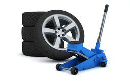 Car jack and wheels Stock Images
