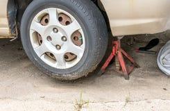 Close up of a car on a tire jack stock photos