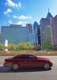 Car on JFK boulevard and Penn Center with skyscrapers. Philadelphia, USA - May 4, 2015: Car on JFK boulevard and Penn Center with skyline of skyscrapers in Stock Photography