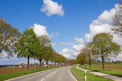 Car journey on country road. In rural bavarian spring landscape Royalty Free Stock Photo