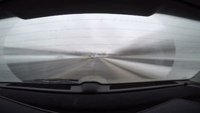 Car journey time lapse, rear view with blurred motion.  stock footage