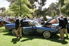 Car Judges Review a Classic Muscle Car at the 2019 San Marino Motor Classic royalty free stock images