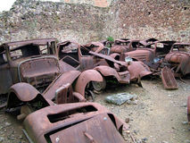 Car Junkyard. A view of old rusted cars in a car junkyard Royalty Free Stock Images