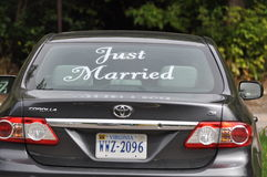 Car with just married on the back windshield Royalty Free Stock Photography