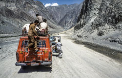 Car on the Karakorum Highway after a landslide. GILGIT, PAKISTAN - JUNE 30, 1987: people on a car stop because of a landslide on the Karakoram Highway. It is the Stock Image
