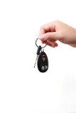 Car key. Hand and car key isolated on white background Stock Photo