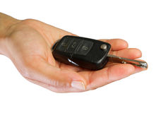 Car key. Hand and car key isolated on white background Royalty Free Stock Photography