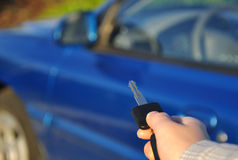 Car key. Man holding a car key Royalty Free Stock Photos