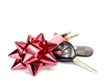 Car key. And  ribbon, on white background Royalty Free Stock Photo
