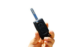 Car Key. A hand showing an opened key of a Peugeot Royalty Free Stock Photos