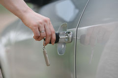 Car key. Inserting Car Key into Vehicle Door Royalty Free Stock Photography