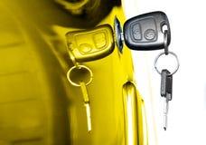 Car Key. Key at car doors - close up Royalty Free Stock Image