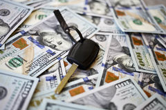 Car key on a background of dollars. Royalty Free Stock Images