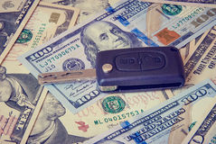Car key on a background of dollars Royalty Free Stock Photos