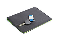 Car key and black folder Stock Image