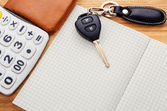 Car key on blank notebook with pocket money Royalty Free Stock Photo