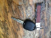 Car key on brown wooden used background. royalty free stock image