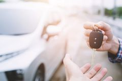 Car key, businessman handing over gives the car key to the other woman royalty free stock photos