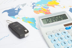 Car key with calculator over print with world map series Stock Photos