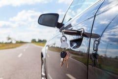 Car key on car lock stock images