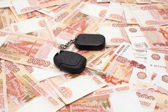 Car key on cash Stock Photography