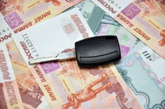 Car key on cash Stock Images