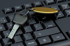 Car key on computer keyboard Royalty Free Stock Photo