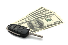 Car Key and Dollars. Car Key and Dollars isolated on white Royalty Free Stock Photo