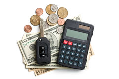 Car key with dollars and calculator Stock Photo