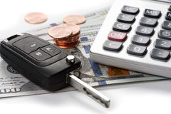 Car key with dollars and calculator Stock Images
