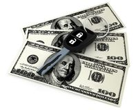 Car key and 100 dollars Stock Photo