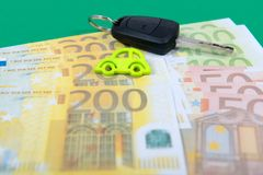 Car key and euro money on green carpet Royalty Free Stock Images