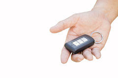 Car-key exchange. A hand holding car keys and a remote control for key-less entry isolated over white royalty free stock photography