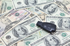 Car key of German car on pile of US dollar banknotes Stock Photography