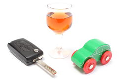 Car key, glass of wine and toy car. White background Stock Photo