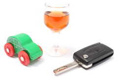 Car key, glass of wine and toy car. White background Royalty Free Stock Images