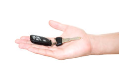 Car key on hand. Isolated on white stock photo